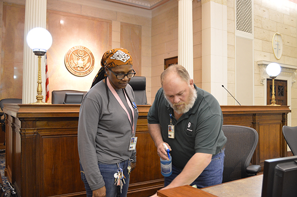 Rick demonstrates cleaning techniques to a trainee inside the Federal Courthouse.
