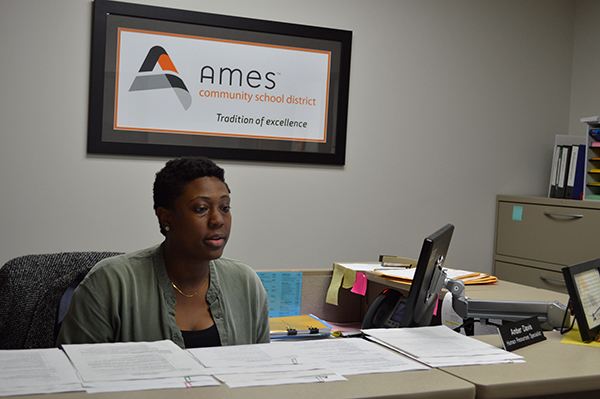 Amber looks over HR forms at her job.