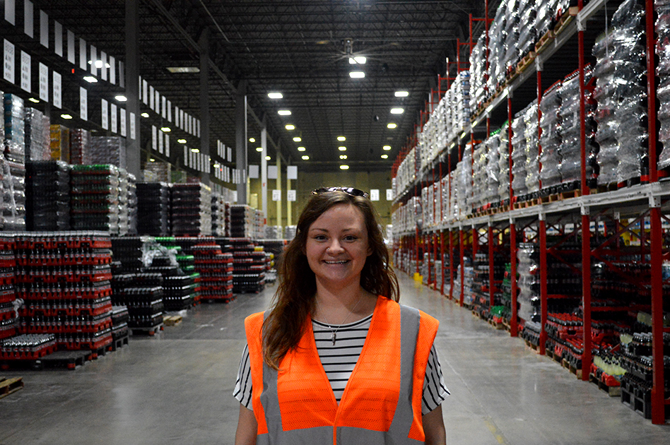 Hannah poses for a picture at the Atlantic Bottling Company warehouse.