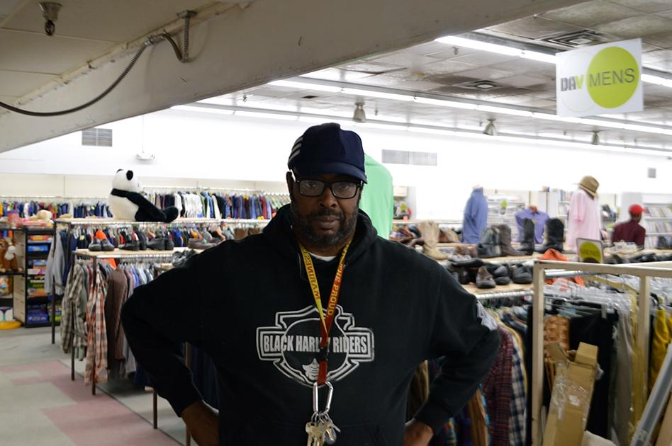 John poses in the DAV thrift store.